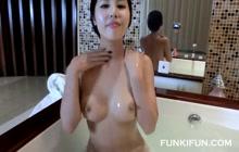 Japanese girl having fun in bathtub